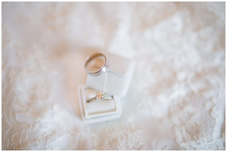 An image of a closeup display of the bride and groom's wedding rings by Columbus Ohio wedding photographer, Alayna Parker Photography