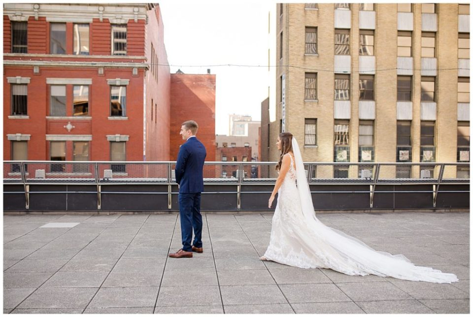 bride and groom about to see each other on rooftop at renaissance hotel