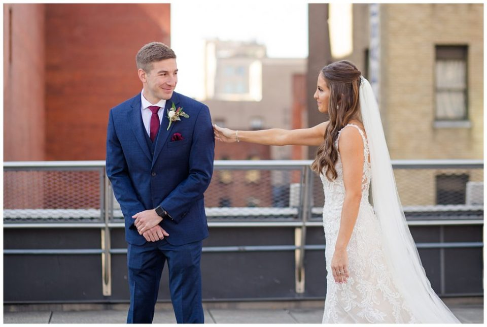groom turns around to see bride for first time on rooftop at renaissance hotel