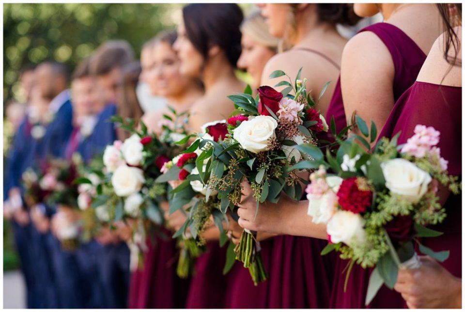 close up of bridesmaids holding bouquets