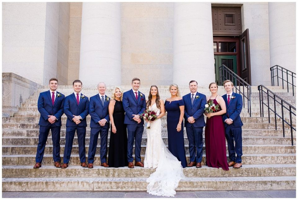 bride and groom and both families outside ohio statehouse