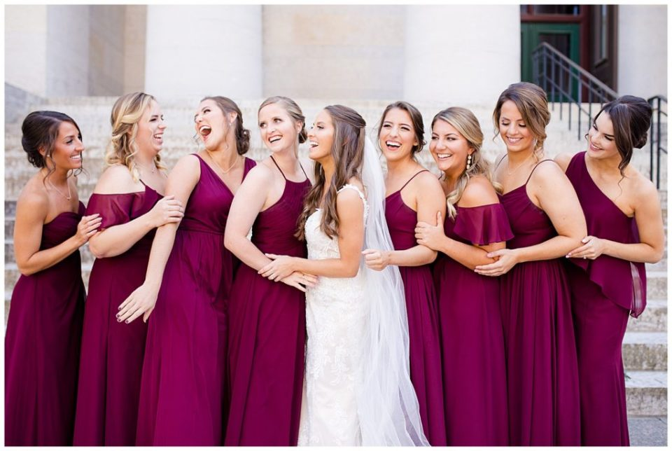 bride and bridesmaids laughing outside ohio statehouse