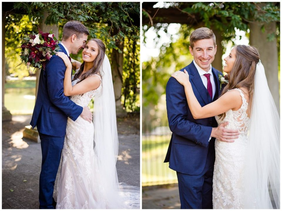 groom smiling at camera while bride smiles at groom at schiller park in german village