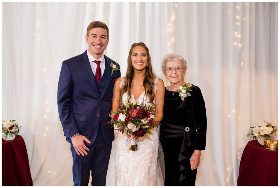 bride and groom with bride's grandmother at copius