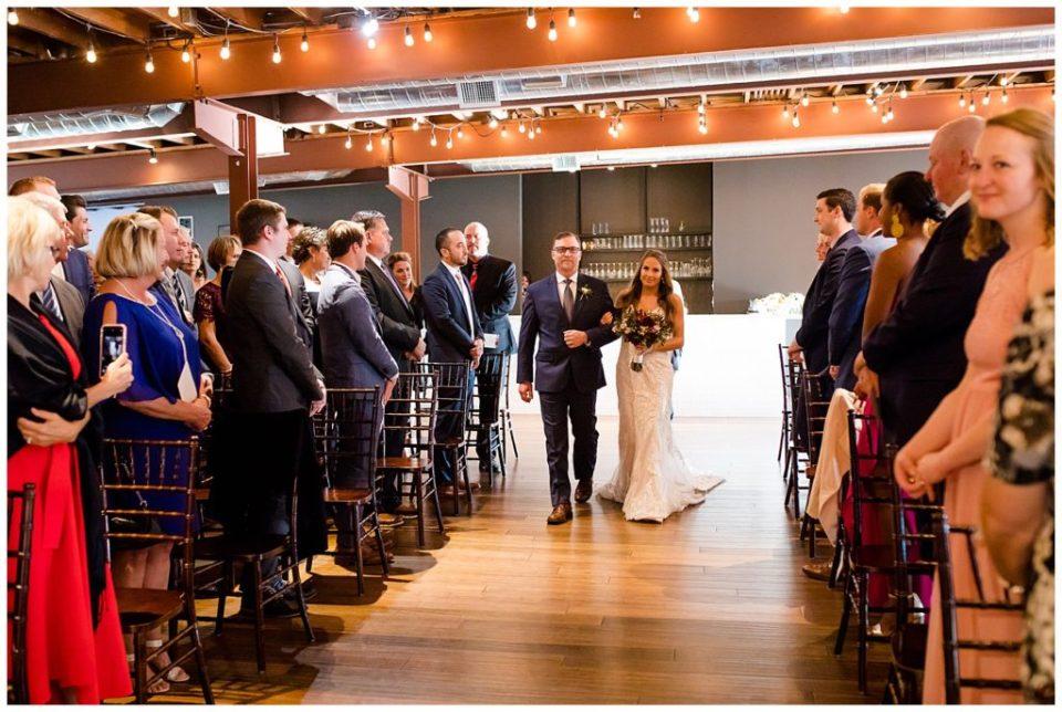 bride walking down aisle at copius