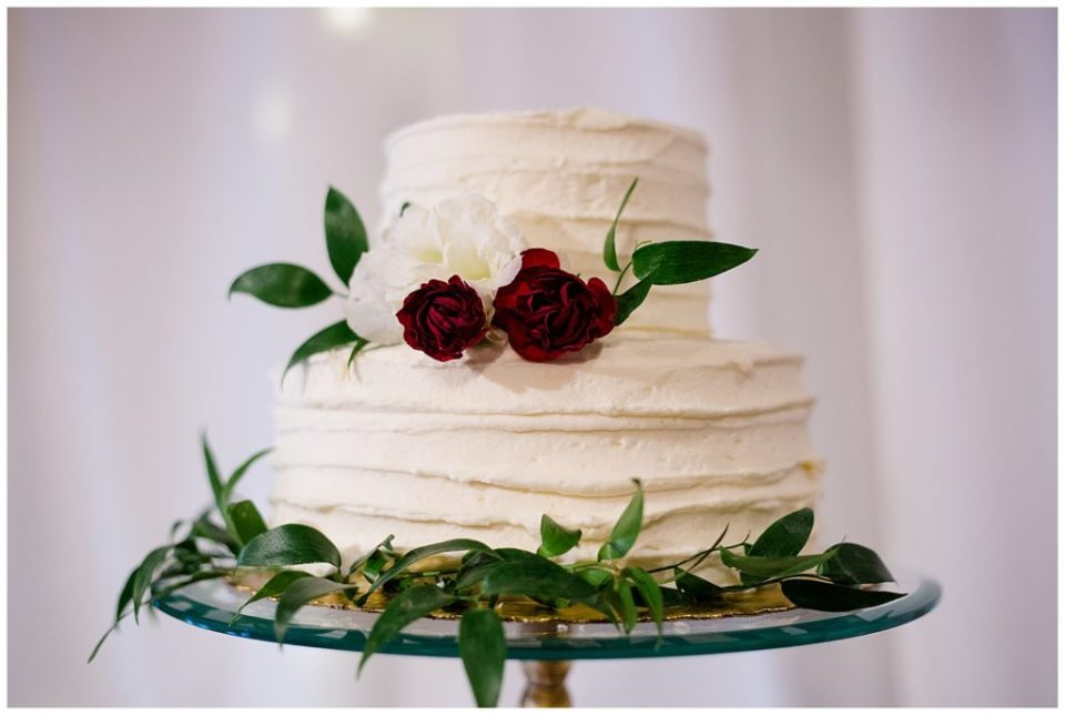 two tiered white wedding cake at copius