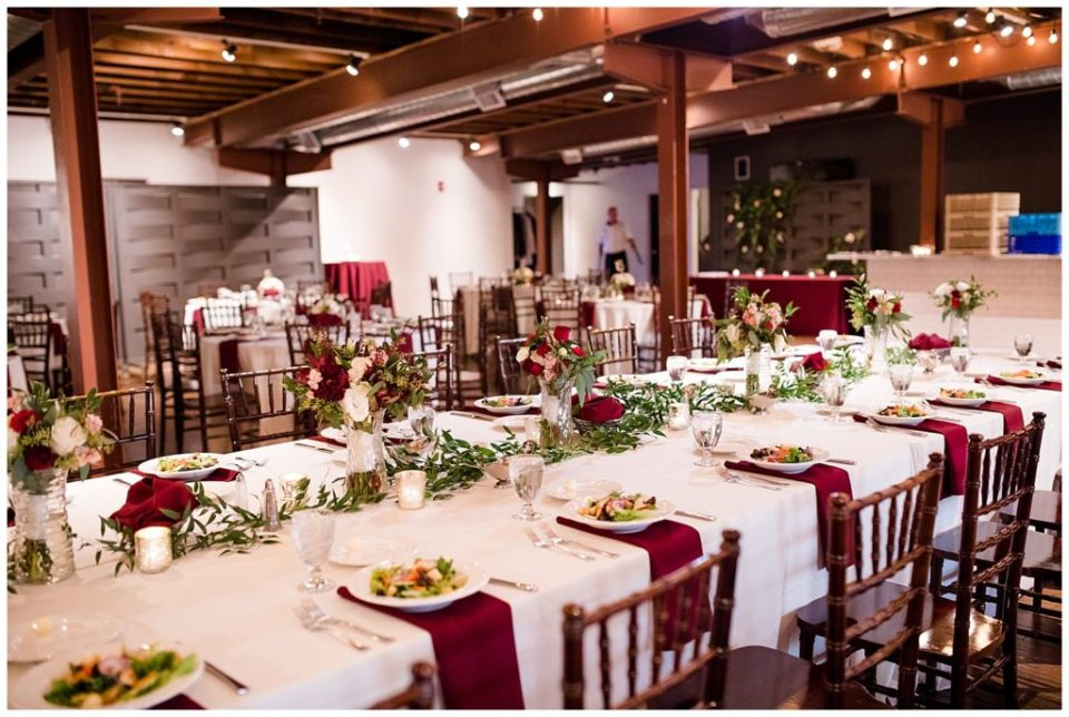 long head table with greenery garland at copius