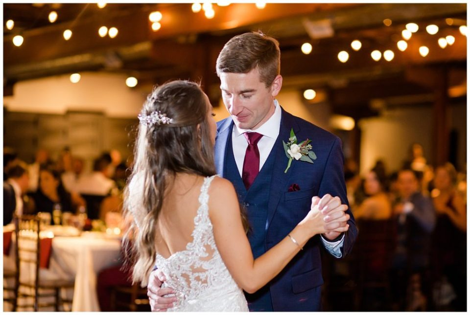 bride and groom share first dance at copius