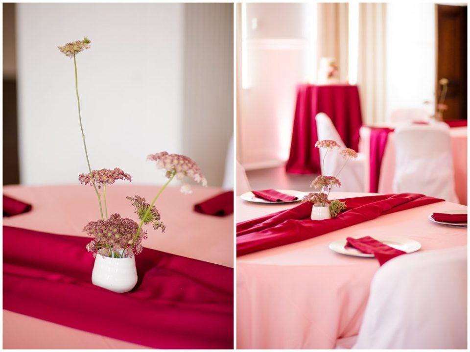 pink and burgundy table decorations at the postmark