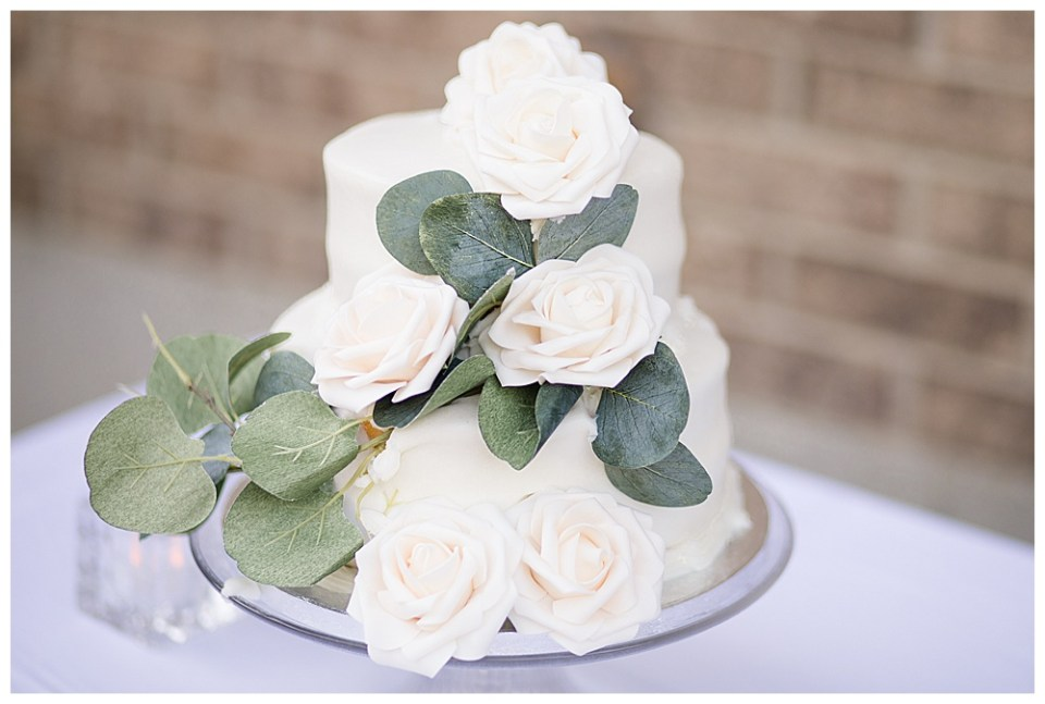 beautiful wedding cake inspiration with eucalyptus leaves and roses