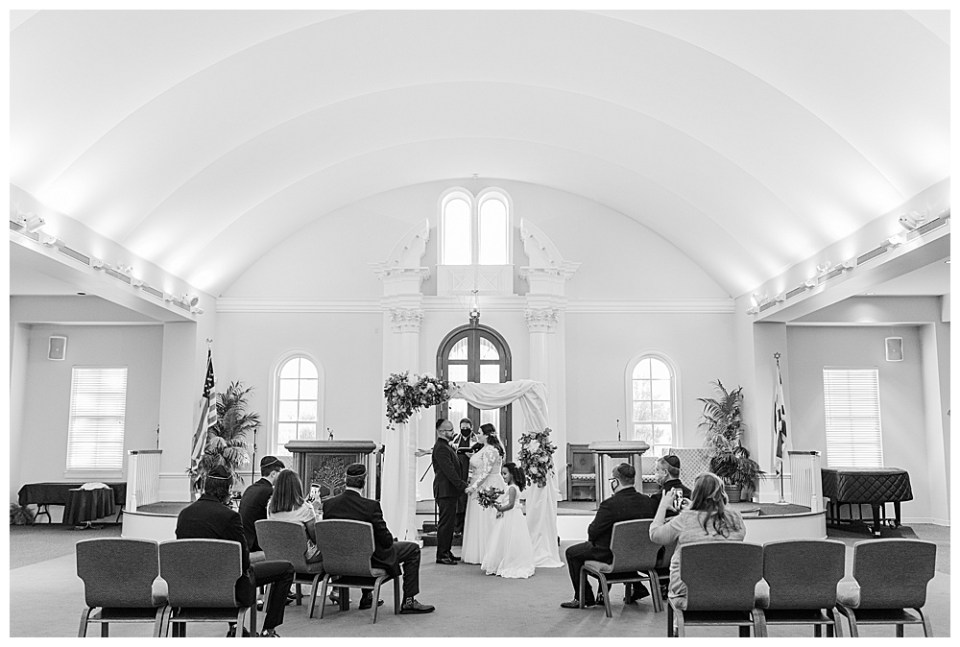 black and white image of a petite wedding with less than 10 guests by small wedding photographer, Alayna Parker