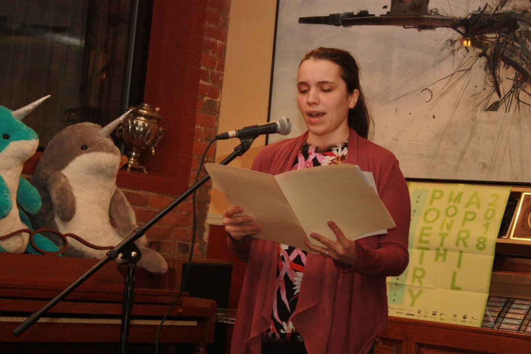 Photo of Danielle Pouliot reading at the Hudson River Coffeehouse in Albany, NY