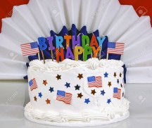 4Th Birthday Cake July 4th Birthday Cake With Patriotic Banner In Background Stock