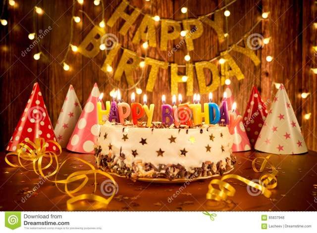 Happy Birthday Cake With Candles Happy Birthday Cake With Candles On The Background Of Garlands A