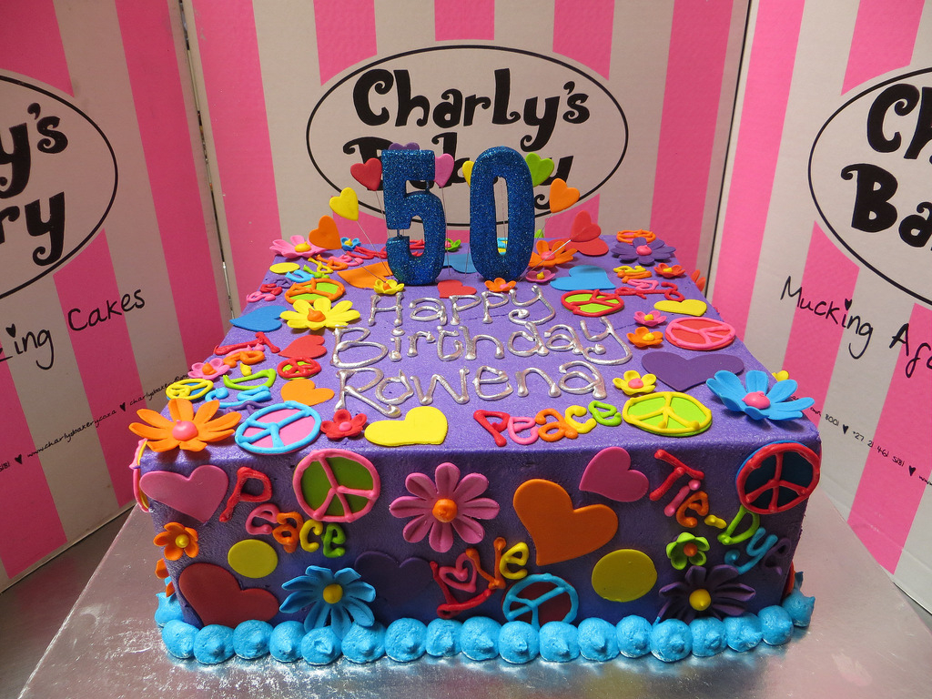 Hippie Birthday Cake Themed 50th Iced In Purple Butter Icing With