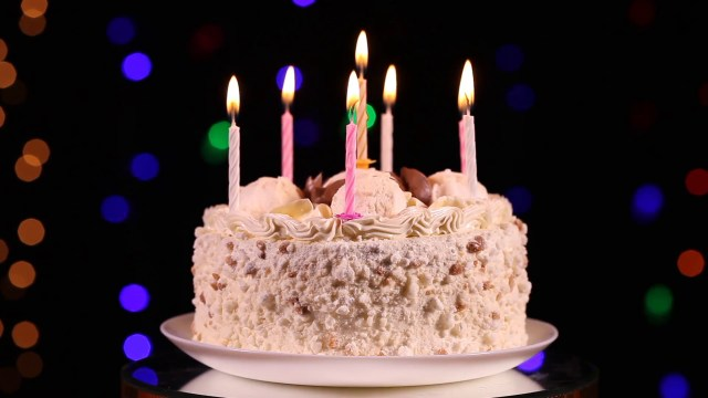 Images Of Happy Birthday Cake Happy Birthday Cake With Burning Candles In Front Of Black
