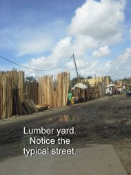 Lumber yard. Notice the typical street.