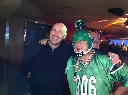 The author with David Ash of Dash Tours at the Riders In the Sky Kickoff Party during the 100th Grey Cup celebrations. David is now the biggest Rider in the sky.
