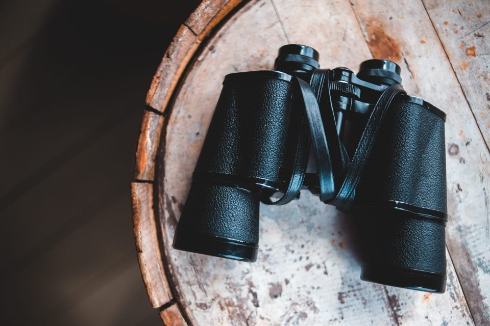 A pair of binoculars on a barrel