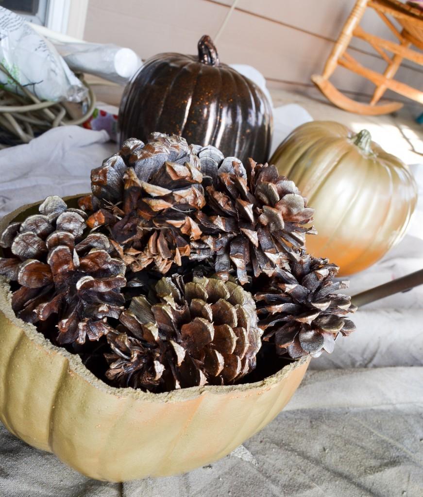 gold pumpkin and pinecones