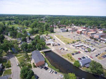 """Albion's Stoffer Plaza is just east of Superior Street, which is Albion's """"main street."""" This view shows a foot bridge that leads into Porter Street nearby. It also shows the nearby Kalamazoo River and parks."""