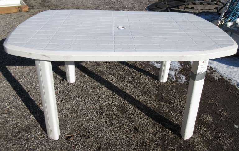 white plastic outdoor table with