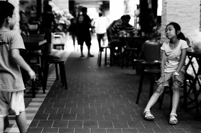 At play - Shot on Ilford FP4+ at EI 400. Black and white film in 35mm format. Push processed 1+1/3 stops.