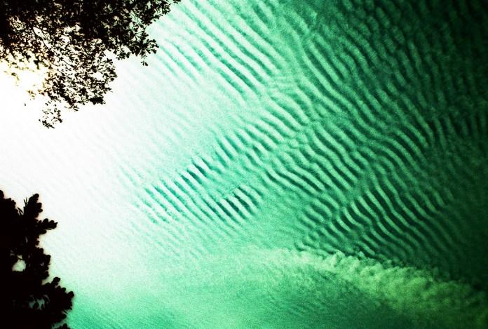Emerald skyscape - Shot on Kodak EKTACHROME 100D Color Reversal Film 5285 at EI 100. Color reversal (slide) motion picture film in 35mm format. Cross processed.