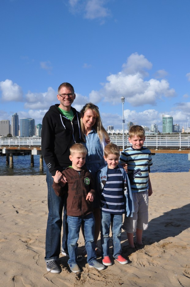 Dale's whole family with Downtown San Diego in the background