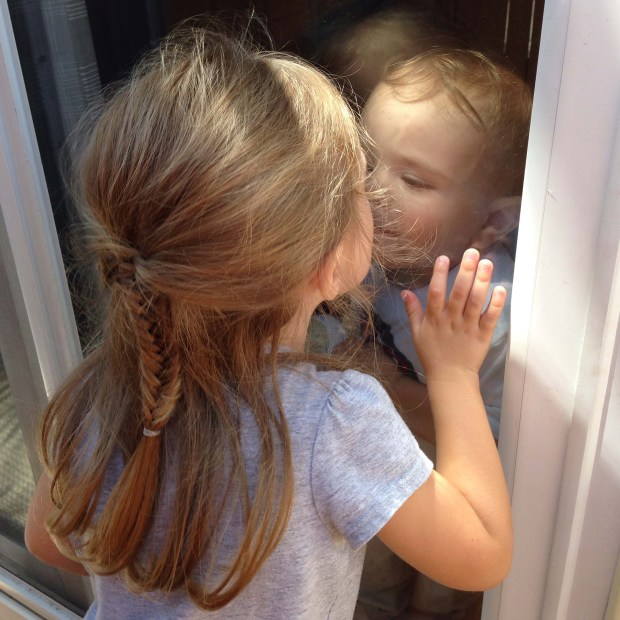 Window Kisses with Brother