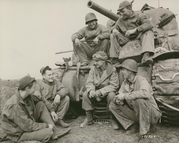 Photo of Ernie Pyle and tank crew