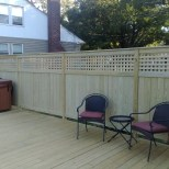Privacy fence with a square lattice top