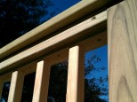 Small pressure treated deck in South Portland - detail of the sanded railing