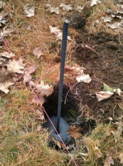 "A 36"" iron rod is insterted into the hole and anchored with cement"