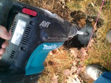 Drilling the hole in the bedrock with a rotary hammer drill