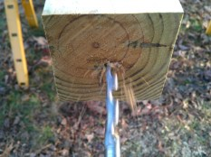 "An 18"" hole in the fence post to accept the rebar"