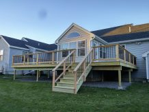 View from the back. The deck is 32 feet wide and 22 feet deep. The railing has a total of 188 balusters.