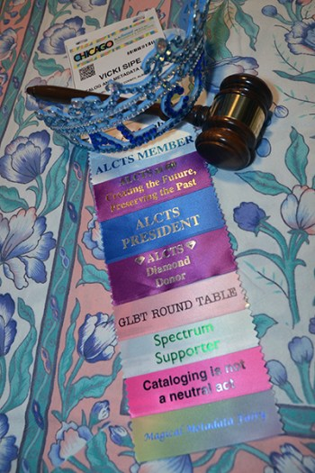 Conference badge, ribbons, and ALCTS tiara