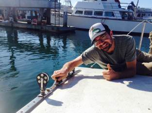 Ed got the jib tracks back on -- after the deck has been re-glassed. Looks good!