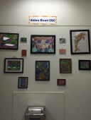 """A """"Gallery Wall"""" on display with a variety of art pieces."""