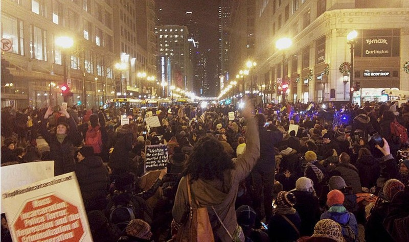 Description  English: Image from protest on December 4th, 2014: Chicago protests after no indictment in Eric Garner chokehold death. Date 4 December 2014, 19:23:30 Source Own work Author Samantha Lotti