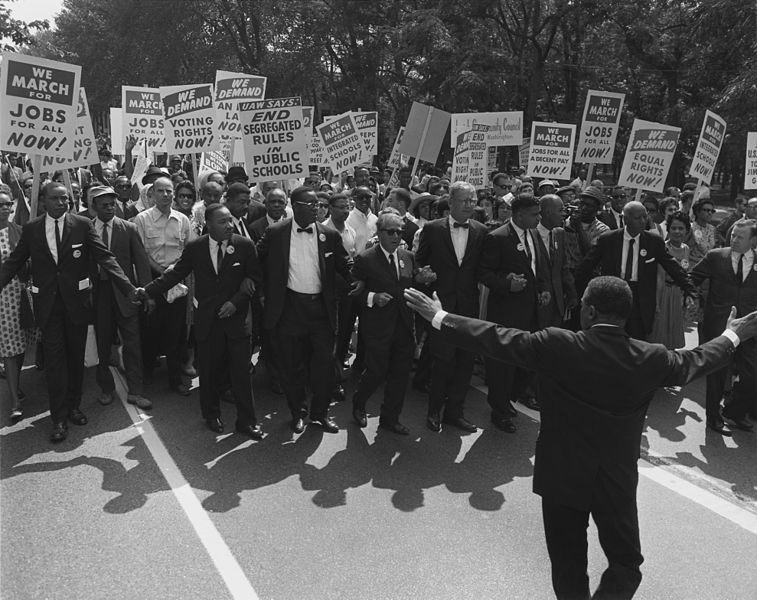 U.S. Information Agency. Press and Publications Service. (ca. 1953 - ca. 1978) Title  Photograph of Leaders at the Head of the Civil Rights March on Washington, D.C. Description  English: This United States Information Agency photograph of the March on Washington, August 28, 1963.      Shows civil rights and union leaders, including Martin Luther King Jr., Joseph L. Rauh Jr., Whitney Young, Roy Wilkins, A. Philip Randolph, Walter Reuther, and Sam Weinblatt. (80-G-413998)     National archive number 80-G-16871     In the Winter 2004, Vol. 36, No. 4 of the National Archives magazine, Prologue, named this image one of its top ten requested images[1]  Date 28 August 1963