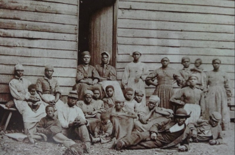 Slaves during slavery in the South. Photograph display on Gullah culture at Boone Hall Plantation.