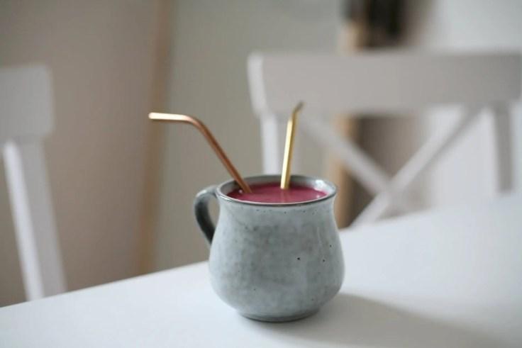 gray ceramic mug with pink beverage