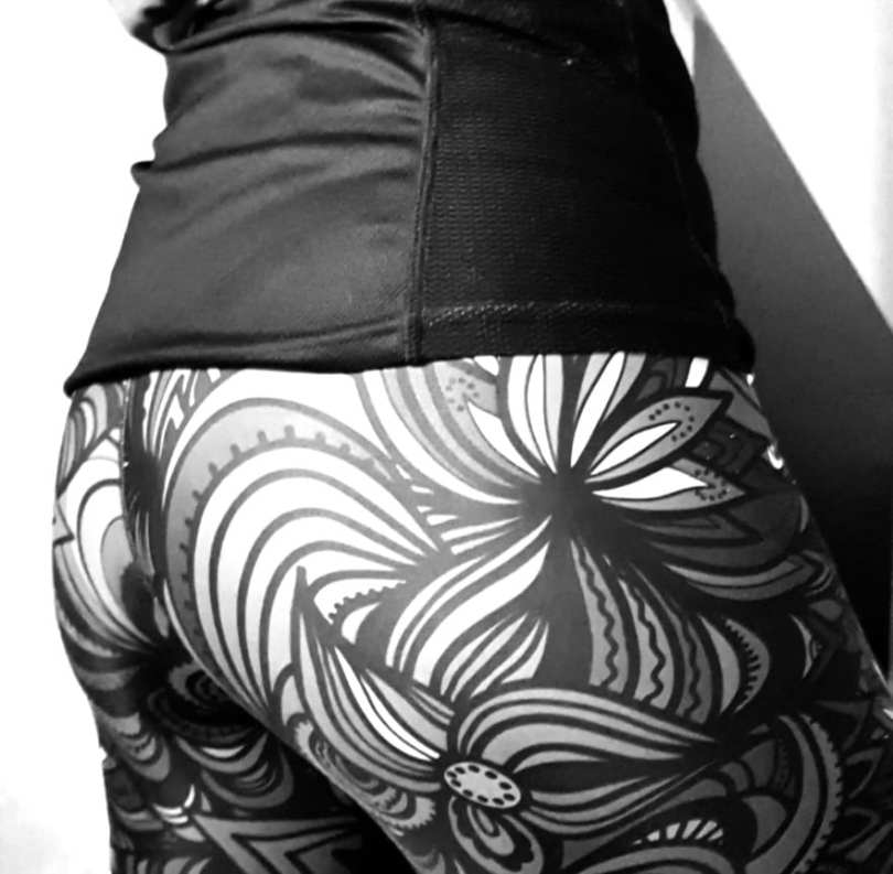 Black and white photo of the barefoot subs lycra clad bottom