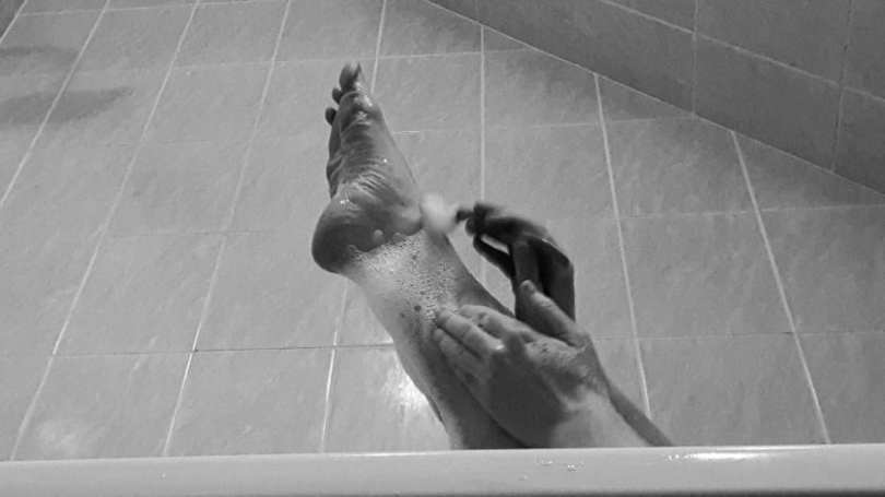 the barefoot subs leg gets a close shave, in black and white