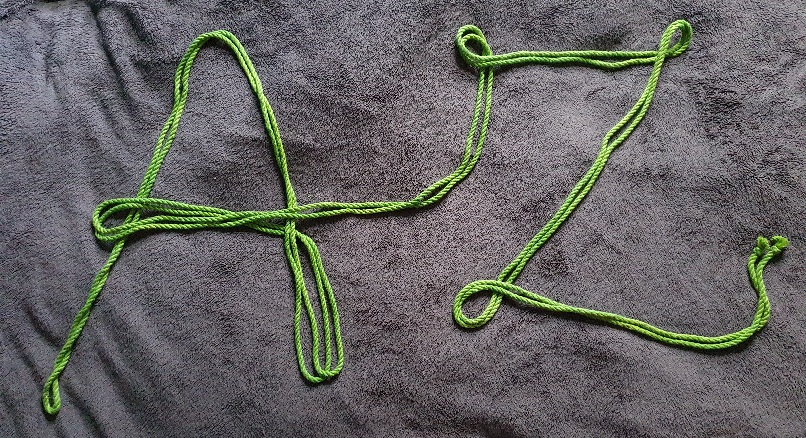 A-Z April Theme reveal, green rope spelling out A-Z