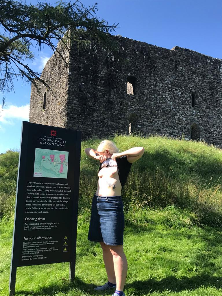 Stone by stone a castle header, lady exposing her breasts in front of a castle