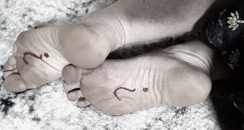 Knowledge is power header image of two bare feet with question marks drawn on them