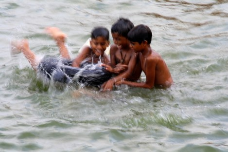 Children playing in the Ganges